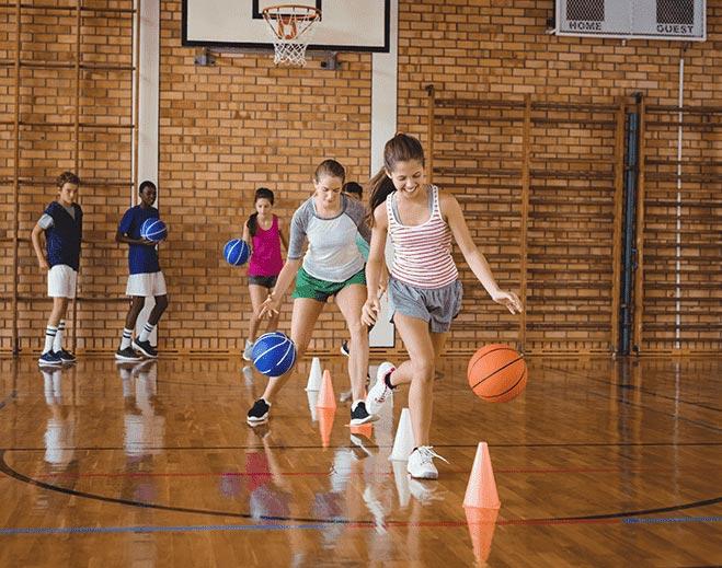 kids dribbling a ball